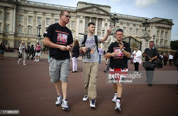 Joint EDL leaders Tommy Robinson and Kevin Carroll march past Buckingham Palace on June 29 2013 in London England The leaders of the English Defence...