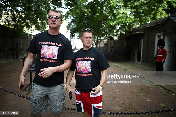 Joint EDL leaders Tommy Robinson and Kevin Carroll pose for a picture just off The Mall on June 29 2013 in London England The leaders of the English...