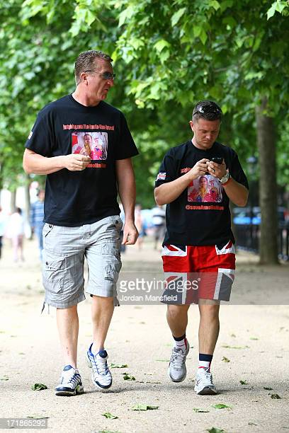 Joint EDL leaders Tommy Robinson and Kevin Carroll walk along The Mall on June 29 2013 in London England The leaders of the English Defence League...