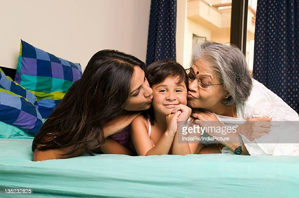 joint family - indian girl kissing stock photos and pictures