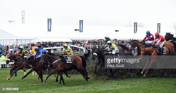 Joint favourite Many Clouds jumps The Chair during the Grand National at Aintree Racecourse in Liverpool north west England on April 9 2016 Rule the...
