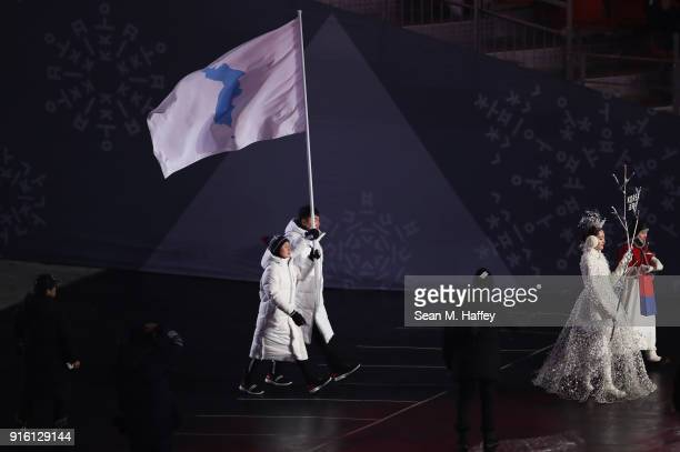 Joint Flag bearers Chung Guam Hwang of Democratic People's Republic of Korea and Yunjong Won of Republic of Korea during the Opening Ceremony of the...