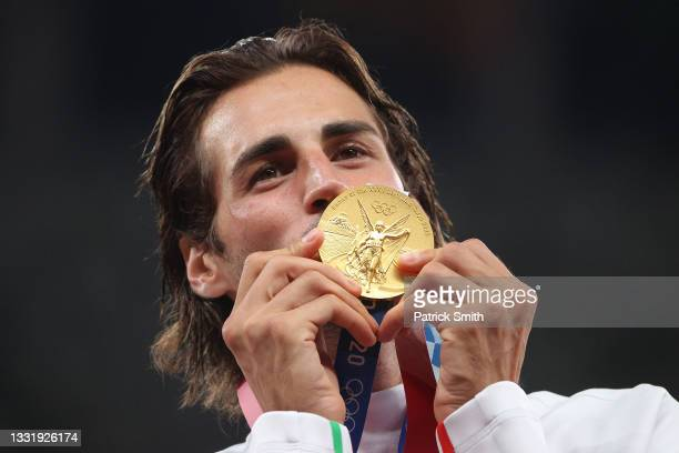 Joint gold medalist Gianmarco Tamberi of Team Italy kisses his medal on the podium during the medal ceremony for the Men's High Jump on day ten of...