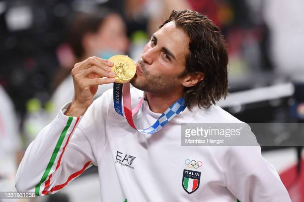Joint gold medalist Gianmarco Tamberi of Team Italy kisses his medal during the medal ceremony for the Men's High Jump on day ten of the Tokyo 2020...