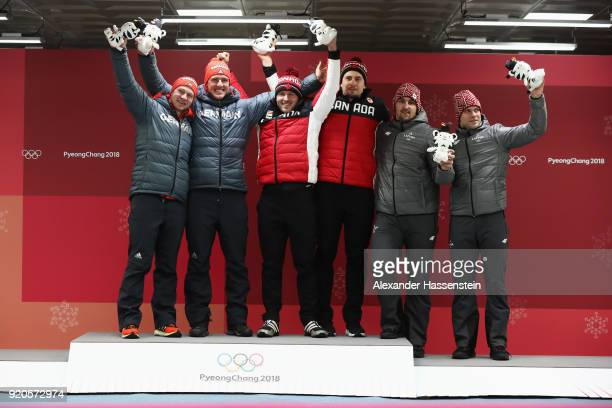 Joint gold medalists Francesco Friedrich and Thorsten Margis of Germany and Justin Kripps and Alexander Kopacz of Canada and bronze medalists Oskars...