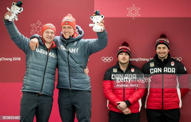 Joint gold medalists Francesco Friedrich and Thorsten Margis of Germany and Justin Kripps and Alexander Kopacz of Canada celebrate during the victory...