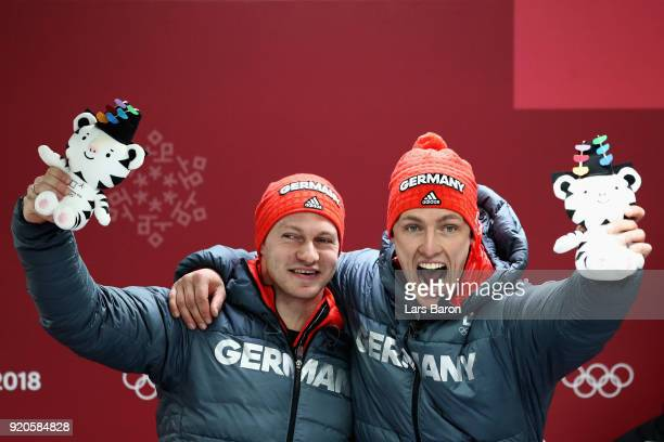 Joint gold medalists Francesco Friedrich and Thorsten Margis of Germany celebrate during the victory ceremony after the Men's 2Man Bobsleigh on day...