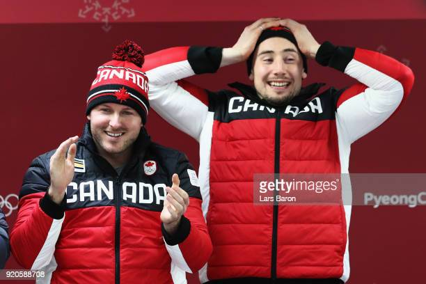 Joint gold medalists Justin Kripps and Alexander Kopacz of Canada celebrate during the victory ceremony after the Men's 2Man Bobsleigh on day 10 of...