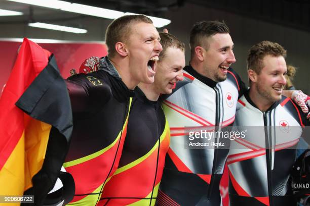 Joint gold medalists Thorsten Margis and Francesco Friedrich of Germany and Alexander Kopacz and Justin Kripps of Canada celebrate after the Men's...