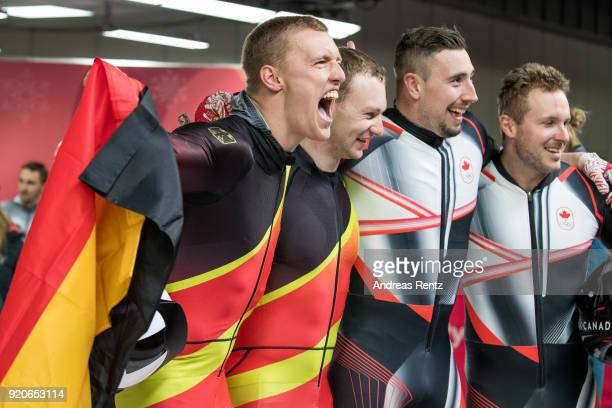 Joint gold medalists Thorsten Margis and Francesco Friedrich of Germany and Justin Kripps and Alexander Kopacz of Canada celebrate during the Men's...