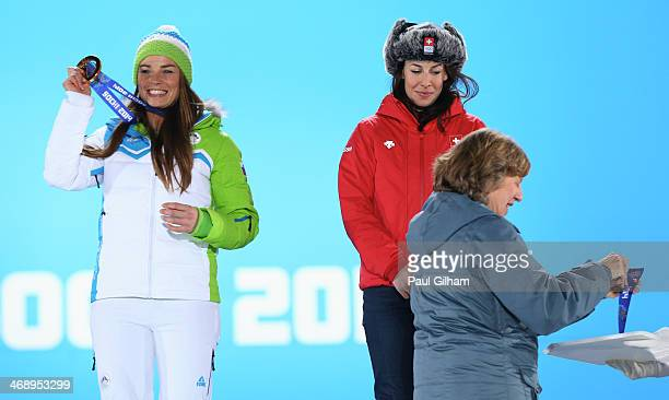 Joint gold medalists Tina Maze of Slovenia and Dominique Gisin of Switzerland celebrate on the podium during the medal ceremony for the for the...