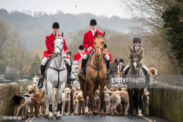 Joint Master and Huntsman Stuart Radbourn leads riders that have arrived for the Avon Vale Hunt's traditional Boxing Day meet in Lacock near...