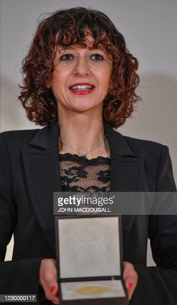 Joint Nobel prize winner for chemistry, French researcher in Microbiology, Genetics and Biochemistry Emmanuelle Charpentier poses with her Nobel...