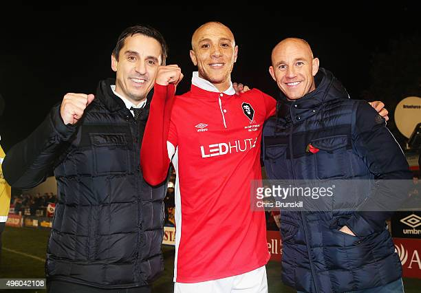 Joint Salford City owners Gary Neville and Nicky Butt celebrate victory with goalscorer Richie Allen of Salford City after the Emirates FA Cup first...