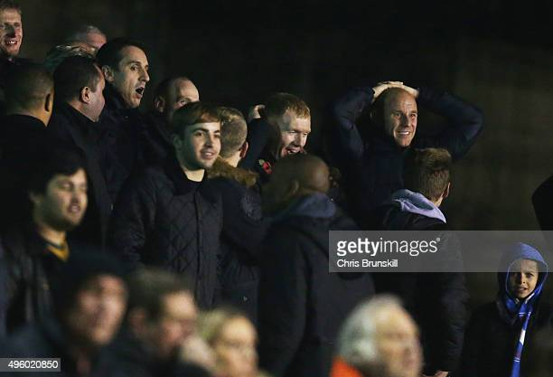 Joint Salford City owners Gary Neville Paul Scholes and Nicky Butt react to a missed chance during the Emirates FA Cup first round match between...