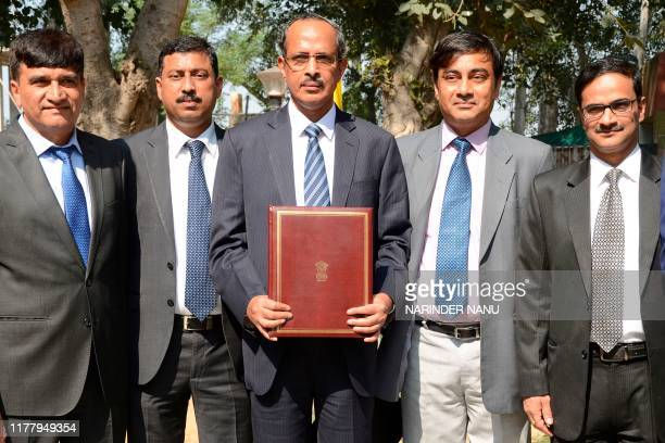 Joint Secretary of Indian Home Ministry SCL Das along with officials holds a document file after signing the agreement with Pakistan on the...