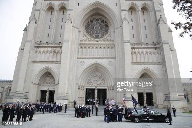 A joint service honor guard carries the casket of former US President George HW Bush to the Washington National Cathedral on December 5 2018 in...