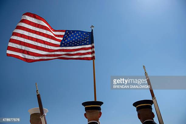 Joint service honor guard holds the US flag during arrival ceremonies for Brazilian Minister of Defense Jaques Wagner at the Pentagon June 29, 2015...