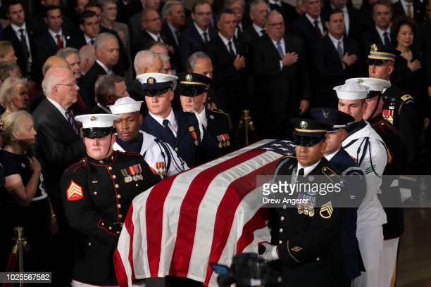A joint service military casket team carries in the flagdraped casket of the lateSen John McCain during a ceremony in his honor at the Rotunda of the...