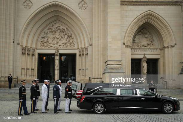 A joint service military casket team prepares to unload the casket of the late Senator John McCain at the Washington National Cathedral for the...