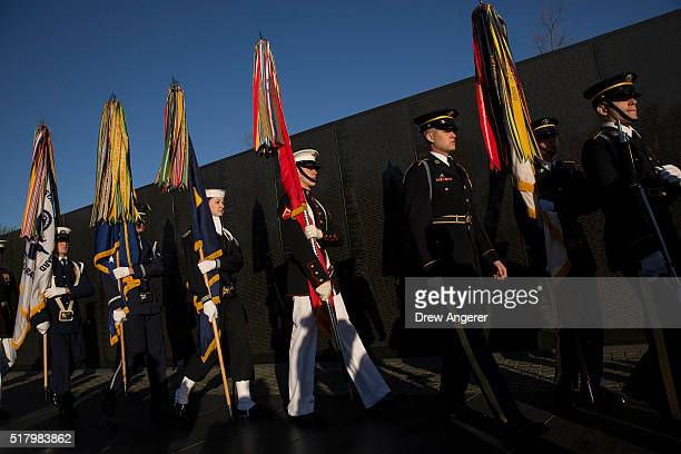 Joint Services Honor Guard arrives prior to a wreath laying ceremony to commemorate the 50th anniversary of the Vietnam War at the Vietnam Veterans...