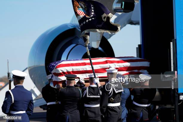 Joint services military honor guard carry the flagdraped casket of the remains of President George HW Bush during a departure ceremony to Washington...