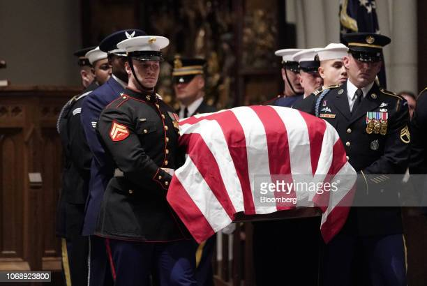 Joint services military honor guards carry the casket of former US President George HW Bush while arriving at St Martin's Episcopal Church in Houston...