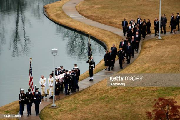 Joint services military honor guards carry the casket of former U.S. President George H.W. Bush for burial at the George H.W. Bush Presidential...