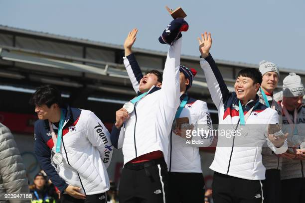 Joint silver medalists Yunjong Won Junglin Jun Seo Youngwoo and Donghyun Kim of Korea celebrate on the podium during the medal ceremony after the...