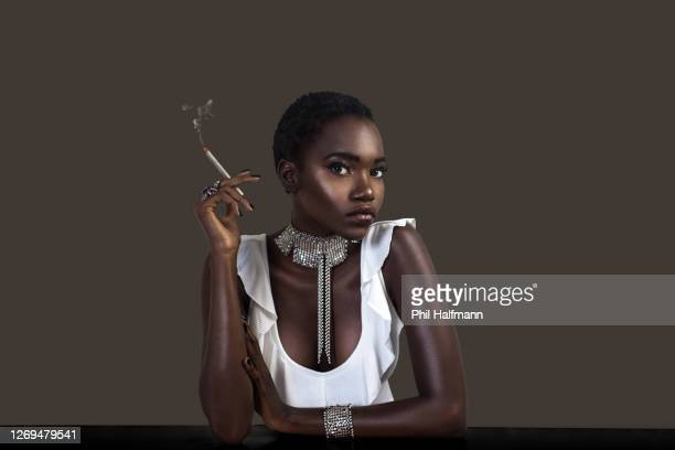 joint smoking sexy black lady in silver jewelry - black nail polish stock pictures, royalty-free photos & images
