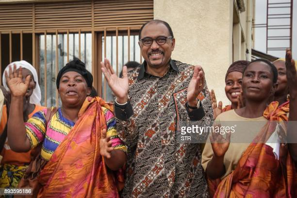 Joint United Nations Programme on HIV/AIDS Executive director and UN Deputy General Secretary Michel Sidibe reacts alongside people living with...
