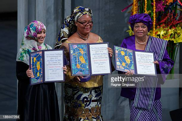 Joint winners Yemeni journalist and activist Tawakul Karman Liberian activist Leymah Gbowee and Liberian President Ellen Johnson Sirleaf hold up...