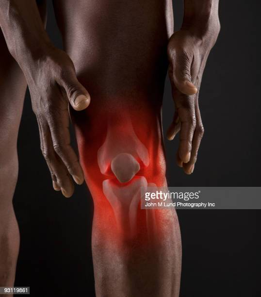 Joints of mixed race man's knee