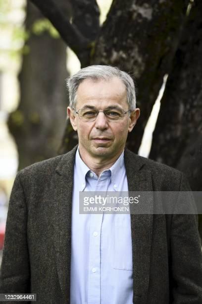 Joint-winner of the 2020 Millennium Technology Prize, British professor Sir David Klenerman poses ahead of the 2020 Millennium Technology Prize award...