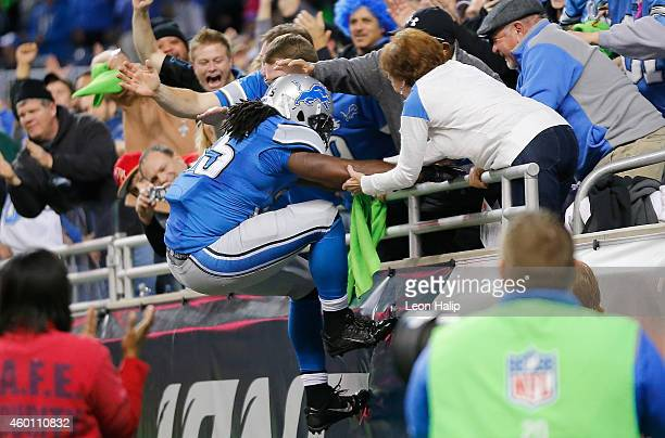 Joique Bell of the Detroit Lions celebrates with fans after scoring a fourth quarter touchdown while playing the Tampa Bay Buccaneers at Ford Field...
