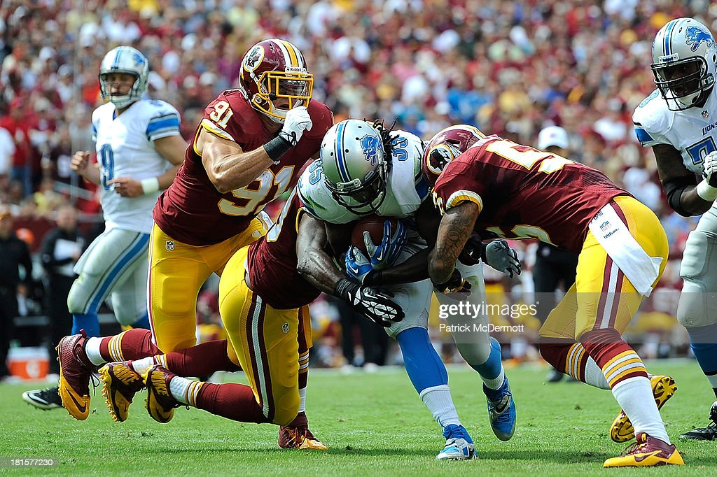 Joique Bell #35 of the Detroit Lions rushes for a touchdown in the first quarter during a game against the Washington Redskins at FedExField on September 22, 2013 in Landover, Maryland.
