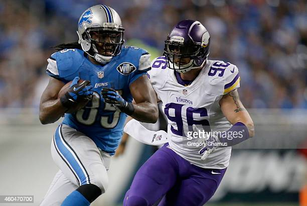Joique Bell of the Detroit Lions tries to outrun the tackle of Brian Robison of the Minnesota Vikings during the third quarter at Ford Field on...