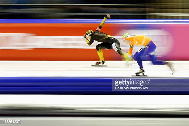 Joji Kato of Japan and Jan Smeekens of Netherlands compete in the Mens 500m during Day 1 of the Essent ISU World Cup Speed Skating Championships 2013...