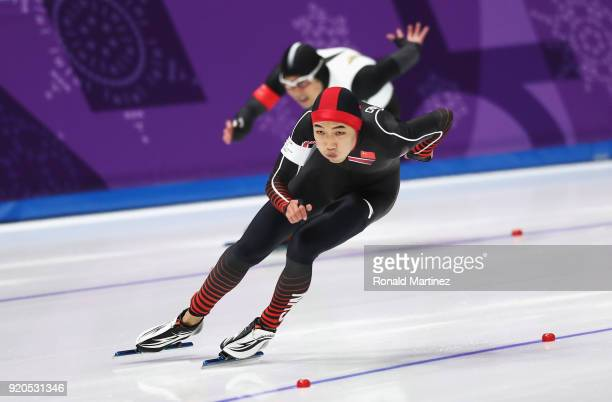 Joji Kato of Japan and Tingyu Gao of China compete during the Men's 500m Speed Skating on day 10 of the PyeongChang 2018 Winter Olympic Games at...