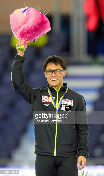 Joji Kato of Japan celebrates on the podium after winning gold in the Men's 500m Division B during day two of the ISU Speed Skating World Cup...