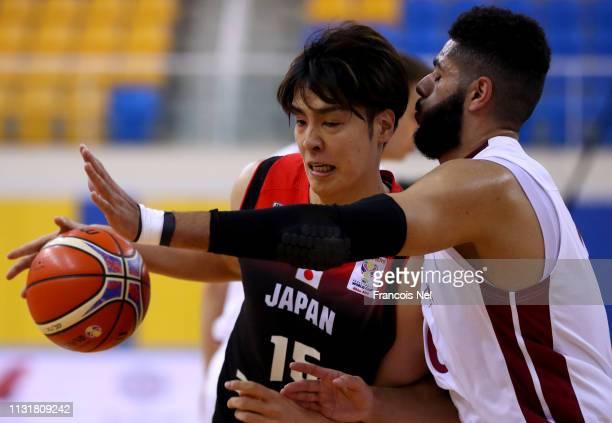 Joji Takeuchi of Japan and Abdelrahman Yehia Abdelhaleem of Qatar in action during the FIBA World Cup Asian Qualifier match between Qatar and Japan...