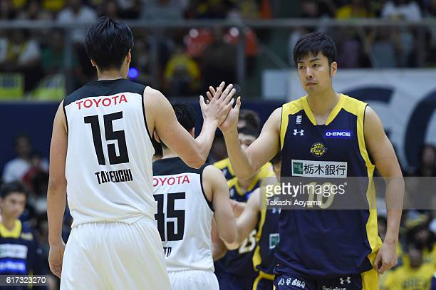 Joji Takeuchi of the Alvark Tokyo and Kosuke Takeuchi of the Tochigi Brex high five after the B League match between Tochigi Brex and Alvark Tokyo at...