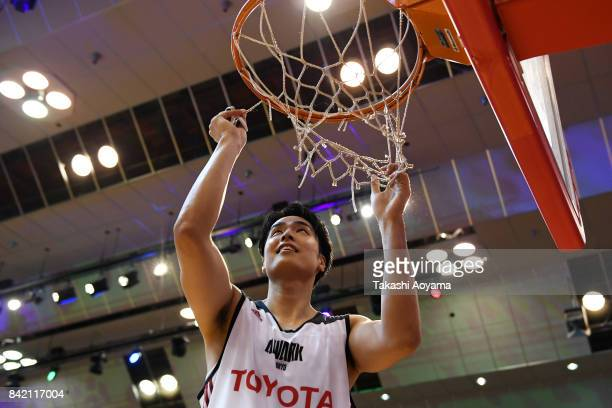Joji Takeuchi of the Alvark Tokyo cuts down the net after defeating the Chiba Jets 77-73 in the B.League Kanto Early Cup final between Alvark Tokyo...