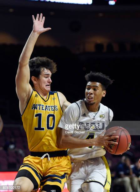 Jojo Anderson of the Northern Arizona Lumberjacks drives against Riley Welch of the UC Irvine Anteaters during the 2017 Continental Tire Las Vegas...