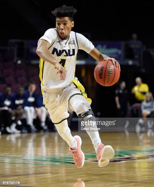 Jojo Anderson of the Northern Arizona Lumberjacks drives the ball against the UC Irvine Anteaters during the 2017 Continental Tire Las Vegas...