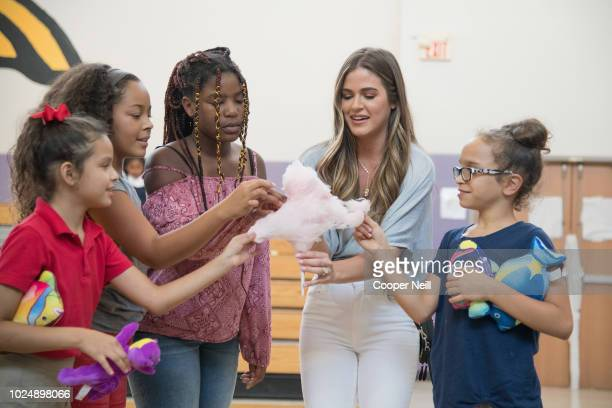 JoJo Fletcher hands out cotton candy to children as Vera Bradley partners with Blessings in a Backpack to continue BacktoSchool Philanthropy Tour at...