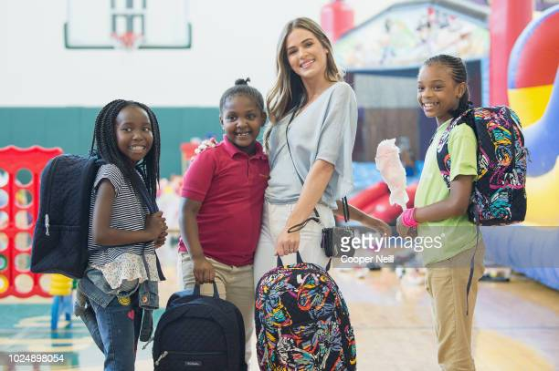 JoJo Fletcher meets with children as Vera Bradley partners With Blessings in a Backpack to continue BacktoSchool Philanthropy Tour at Grand Prairie...