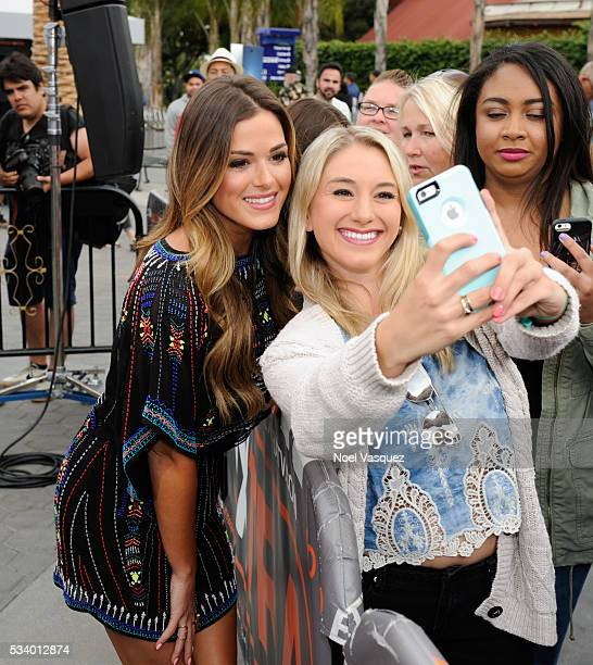 JoJo Fletcher takes a selfie with a fan at Extra at Universal Studios Hollywood on May 24 2016 in Universal City California