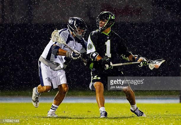 JoJo Marasco of the New York Lizards controls the ball against Dan Burns of the Chesapeake Bayhawks during their Major League Lacrosse game at Icahn...