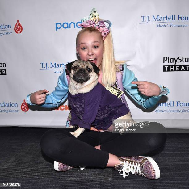 JoJo Siwa and Doug the Pug attend TJ Martell Foundation's 17th Annual New York Family Day at PlayStation Theater on April 8 2018 in New York City